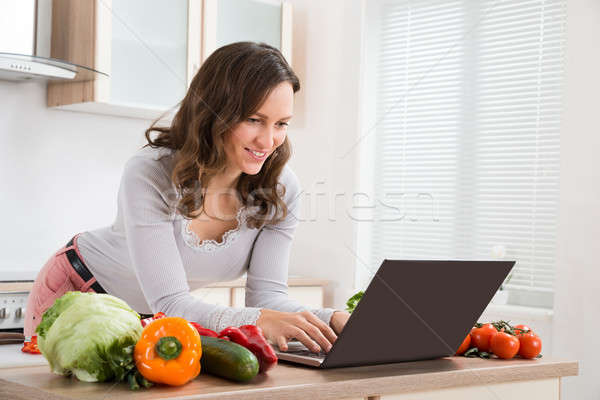 Woman Looking Recipe On Laptop Stock photo © AndreyPopov