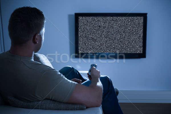 Homme télévision pas signal séance canapé Photo stock © AndreyPopov