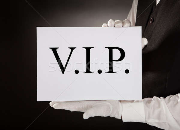 Waiter Holding Board With The Text Vip Stock photo © AndreyPopov