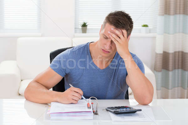Man Calculating Finance Stock photo © AndreyPopov