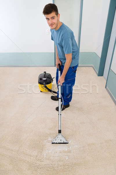 Male Cleaner Vacuuming Floor Stock photo © AndreyPopov