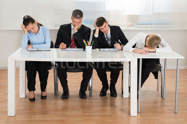 Businesspeople Getting Bored While Working In Office Stock photo © AndreyPopov