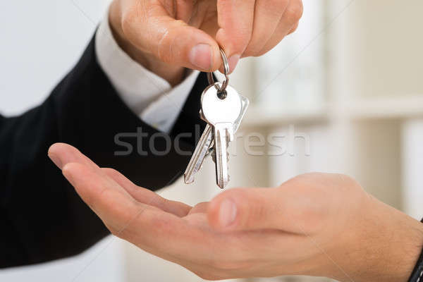 Person Hands Giving Key To Another Person Stock photo © AndreyPopov