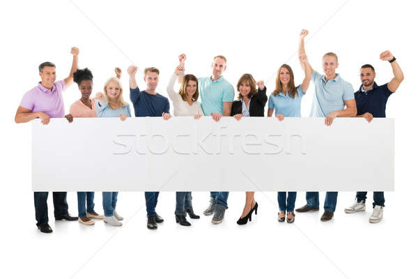 Creative Business Team With Arms Raised Holding Blank Billboard Stock photo © AndreyPopov