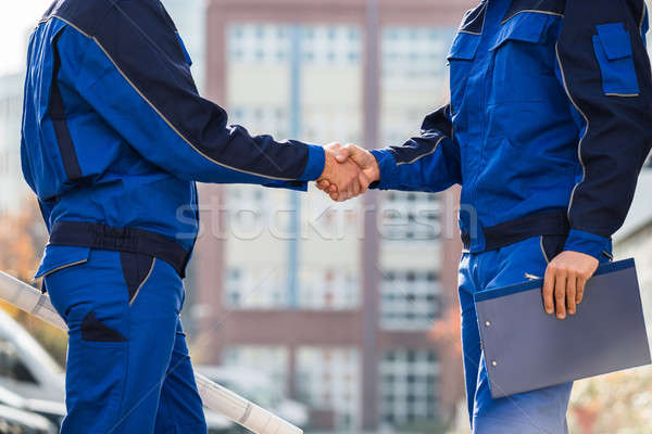 Midsection Of Architects Shaking Hands Outdoors Stock photo © AndreyPopov