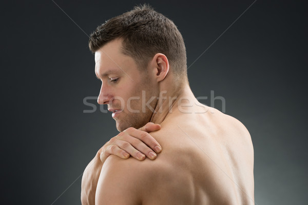 Muscular homem sofrimento ombro dor vista lateral Foto stock © AndreyPopov