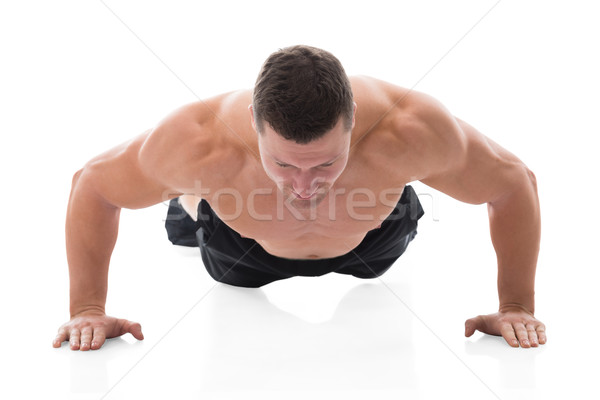 Determined Muscular Man Doing Push Ups Stock photo © AndreyPopov