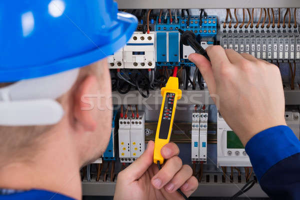 Stock photo: Male Electrician Checking Fusebox