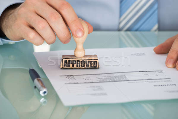 Person's Hand Stamping On Document Stock photo © AndreyPopov