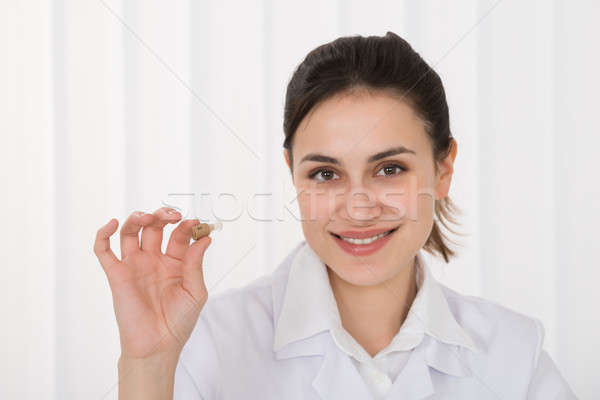 Female Doctor Holding Hearing Aid Stock photo © AndreyPopov