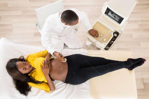 Nőgyógyász terhes nő mozog ultrahang terhes has Stock fotó © AndreyPopov
