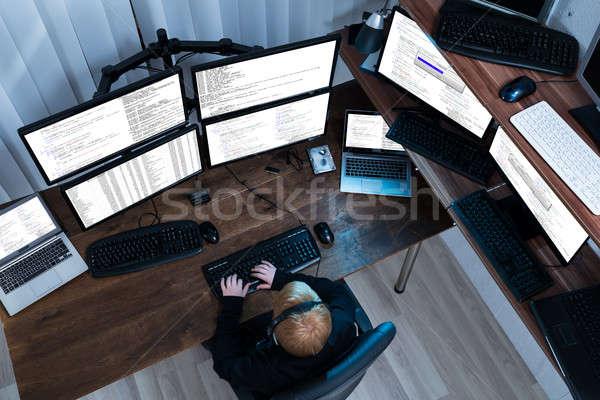 Menino trabalhando múltiplo informática ver Foto stock © AndreyPopov