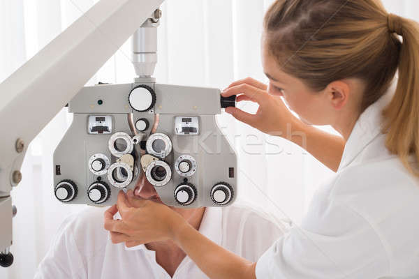 An Optometrist Doing Sight Testing For Patient Stock photo © AndreyPopov