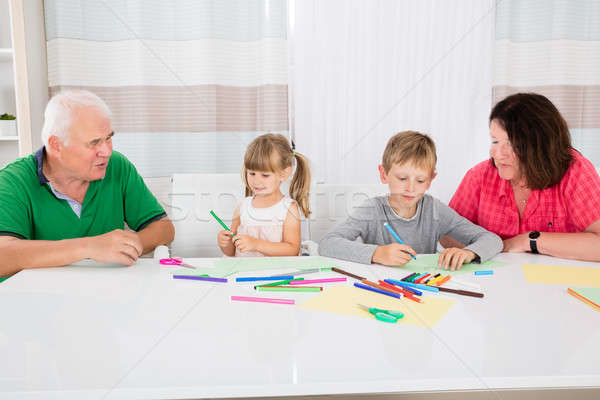 Multi Generation Family Drawing Together With Colorful Pencils Stock photo © AndreyPopov