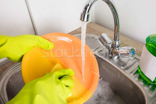 Close-up Of Person Washing Plate Stock photo © AndreyPopov