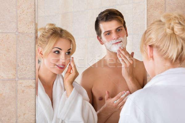 Homem esposa limpeza cara retrato espelho Foto stock © AndreyPopov