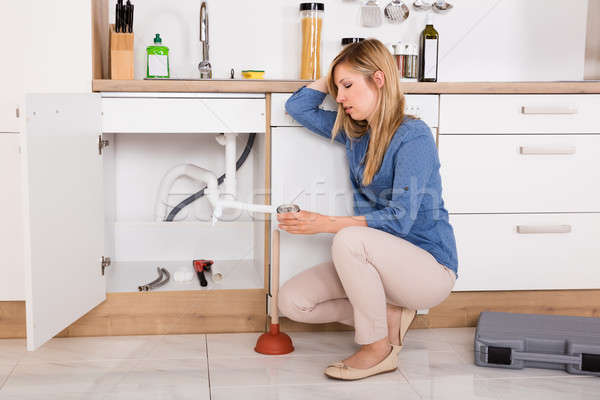 Frustrated Woman Having Kitchen Sink Problem Stock photo © AndreyPopov
