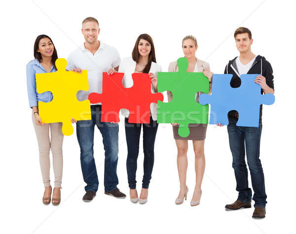 People Assembling Jigsaw Puzzle Stock photo © AndreyPopov