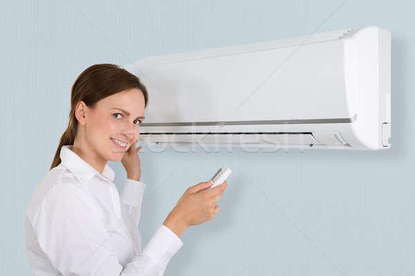 幸せ 女性実業家 空調装置 肖像 オフィス 女性 ストックフォト © AndreyPopov