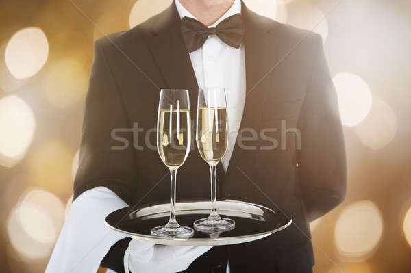 Waiter Serving Glass Of Champagne Stock photo © AndreyPopov