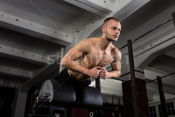 Man Doing Core Exercise On Exercise Equipment Stock photo © AndreyPopov