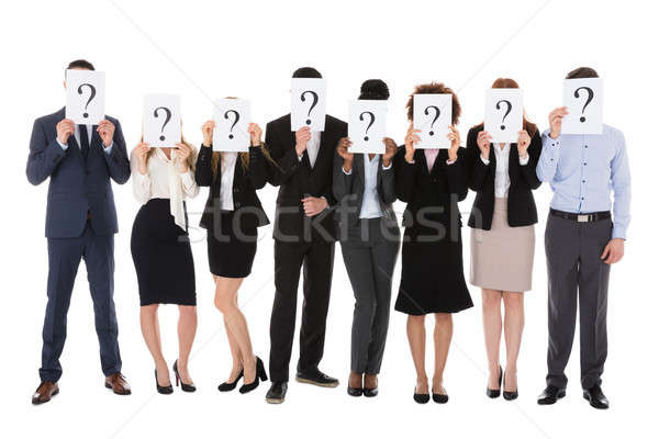 Businesspeople Hiding Behind Question Mark Sign Stock photo © AndreyPopov