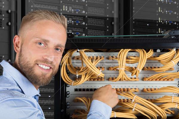 Souriant ordinateur technicien portrait jeunes serveur Photo stock © AndreyPopov
