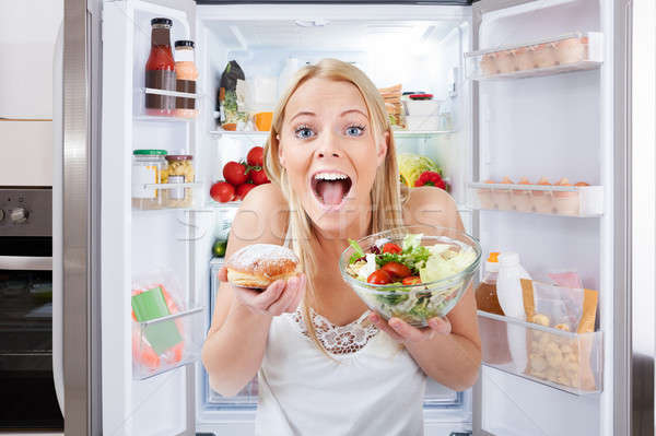 Young Woman Holding Bowl Of Salad And Bun Stock photo © AndreyPopov
