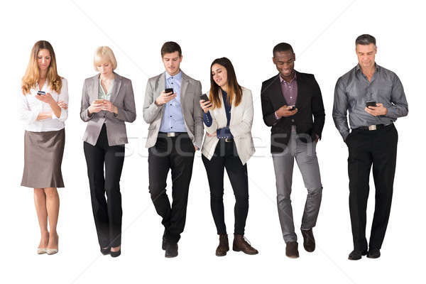 Multi Ethnic Business People Using Cell Phones Stock photo © AndreyPopov