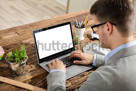 Businessman Checking CCTV Footage On Laptop Stock photo © AndreyPopov