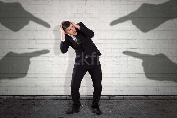 Sombra manos senalando empresario pared miedo Foto stock © AndreyPopov
