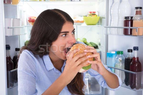 Mutlu kadın yeme Burger portre genç Stok fotoğraf © AndreyPopov