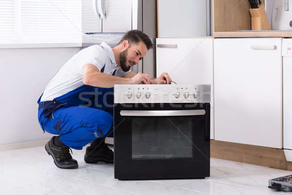 Repairman Repairing Oven Stock photo © AndreyPopov