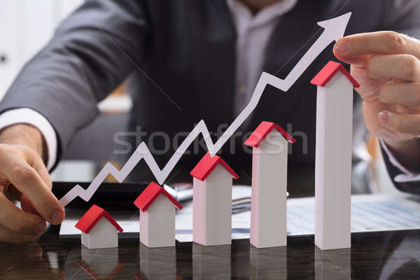 Businessman Showing The Increasing Profit On Property Stock photo © AndreyPopov