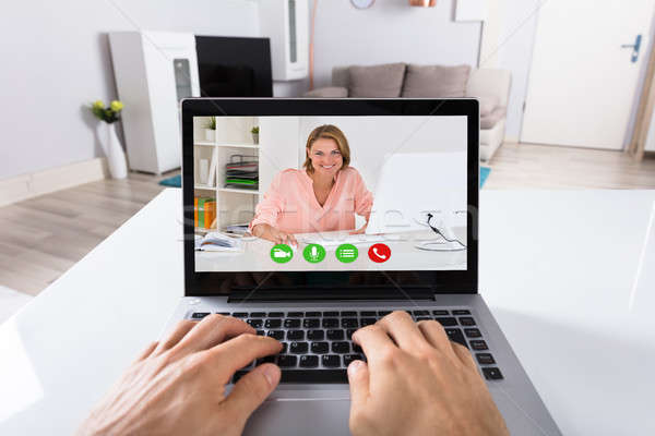 Person Video Conferencing With Woman On Laptop Stock photo © AndreyPopov