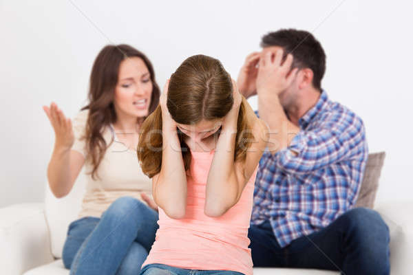 Parent Quarreling Behind Girl Covering Her Ears Stock photo © AndreyPopov