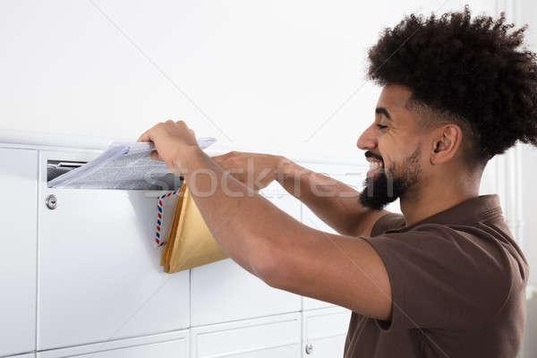 человека письма почтовый ящик вид сбоку молодым человеком стороны Сток-фото © AndreyPopov