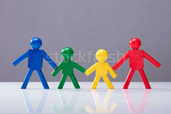 Multi Colored Human Figures Standing In A Row Stock photo © AndreyPopov