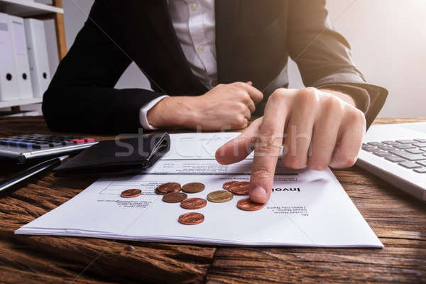 Businessperson's Hand Counting Coins Stock photo © AndreyPopov