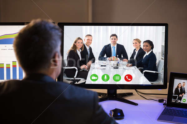 Businessman Video Conferencing With Colleagues On Computer Stock photo © AndreyPopov