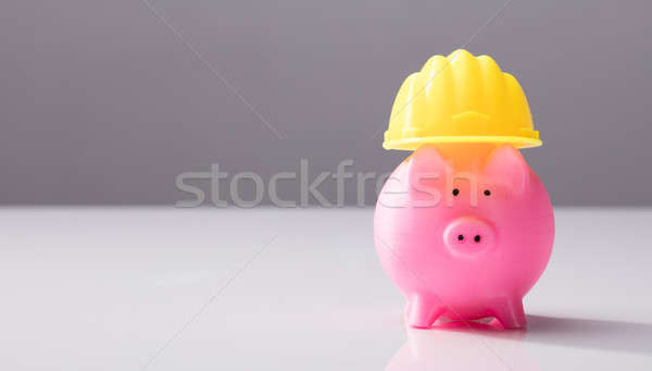 Close-up Of A Piggy Bank With Hard Hat Stock photo © AndreyPopov