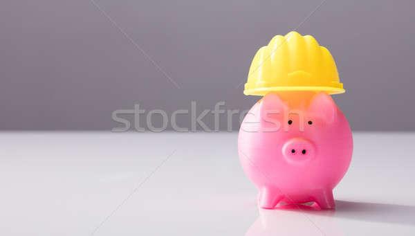 クローズアップ 貯金 ヘルメット ピンク 黄色 白 ストックフォト © AndreyPopov