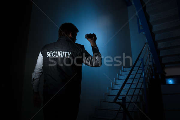 Security Guard Standing Near Stairway Stock photo © AndreyPopov