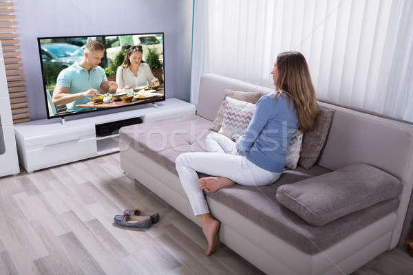 Nő tv nézés otthon érett nő ül kanapé Stock fotó © AndreyPopov