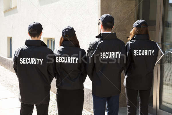 Rear View Of Security Guards Wearing Uniform Stock photo © AndreyPopov