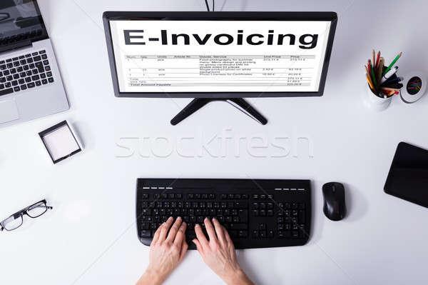 Businessperson Preparing E-invoicing Bill On Computer Stock photo © AndreyPopov