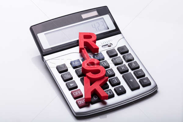 Elevated View Of Risk Word On Calculator Stock photo © AndreyPopov
