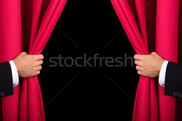 Dois homens abertura vermelho cortina dois Foto stock © AndreyPopov