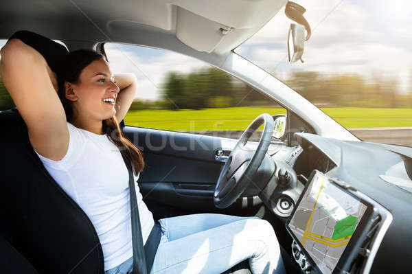 Woman Sitting In Self Driving Modern Car Stock photo © AndreyPopov