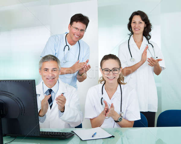 Happy medical team giving a thumbs up Stock photo © AndreyPopov